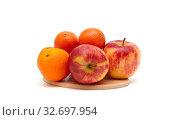 Tangerines, apples and oranges on a white background. Стоковое фото, фотограф Ласточкин Евгений / Фотобанк Лори