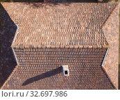 Купить «Top view of tile roof with chimney and shadows.», фото № 32697986, снято 13 октября 2019 г. (c) Ярослав Данильченко / Фотобанк Лори