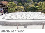 Купить «The sand garden with stripes is called Ginshadan. It is in the Ginkakuji or temple of the Silver Pavilion. The Ginshadan represents one of the Fuji five lakes. Kyoto», фото № 32710354, снято 14 апреля 2013 г. (c) Кекяляйнен Андрей / Фотобанк Лори