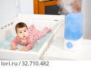 Купить «Air humidifier at bedroom. Ultrasonic device for comfortable living conditions, moisture increase in the apartment», фото № 32710482, снято 8 декабря 2019 г. (c) Кекяляйнен Андрей / Фотобанк Лори