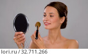 beautiful woman with mirror and makeup brush. Стоковое видео, видеограф Syda Productions / Фотобанк Лори