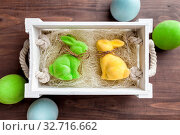 Traditional Easter holiday basket with a bunny and eggs. Стоковое фото, фотограф Zoonar.com/Tomas Anderson / easy Fotostock / Фотобанк Лори