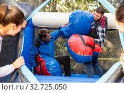 Купить «Male friends fighting at amusement playground», фото № 32725050, снято 28 января 2020 г. (c) Яков Филимонов / Фотобанк Лори