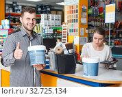 Купить «satisfied man customer with tools for repair», фото № 32725134, снято 17 мая 2018 г. (c) Яков Филимонов / Фотобанк Лори