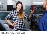 Купить «Young woman is disappointed of tire replacement of her car in spring», фото № 32725226, снято 18 декабря 2017 г. (c) Яков Филимонов / Фотобанк Лори
