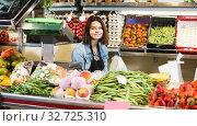 Купить «Female seller is showing assortment», фото № 32725310, снято 18 марта 2017 г. (c) Яков Филимонов / Фотобанк Лори