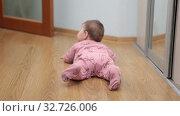 Купить «Six month old baby crawling on floor then turning on belly, rear view», видеоролик № 32726006, снято 10 декабря 2019 г. (c) Кекяляйнен Андрей / Фотобанк Лори
