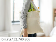 Купить «woman with reusable canvas bag for food shopping», фото № 32740866, снято 3 мая 2019 г. (c) Syda Productions / Фотобанк Лори