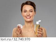 Купить «young woman with toner or cleanser and cotton pad», фото № 32740970, снято 30 ноября 2019 г. (c) Syda Productions / Фотобанк Лори