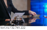 Купить «A silver ring bell - A woman in costume standing by the reception», фото № 32741222, снято 4 июня 2020 г. (c) Константин Шишкин / Фотобанк Лори