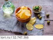 Купить «Potato chips in the glass bowl», фото № 32747366, снято 26 мая 2020 г. (c) easy Fotostock / Фотобанк Лори