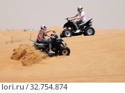 Купить «Dubai, United Arab Emirates, teenagers drive on quads through the desert», фото № 32754874, снято 30 марта 2018 г. (c) Caro Photoagency / Фотобанк Лори