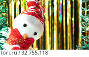 Купить «Cute snowman in red hat and bow looks at you from scene. Christmas greeting on gold background. Festive mood. New Year or holiday theme», видеоролик № 32755118, снято 2 июля 2020 г. (c) Dmitry Domashenko / Фотобанк Лори