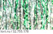 Купить «Green tinsel on silver bokeh background. Beautiful dynamic background in shining lights and sparkling particles. Festive mood. Christmas or holiday theme.», видеоролик № 32755178, снято 17 февраля 2020 г. (c) Dmitry Domashenko / Фотобанк Лори