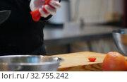 Купить «Cooking on modern kitchen - chef cutting cherry tomatoes on the desk», видеоролик № 32755242, снято 5 июля 2020 г. (c) Константин Шишкин / Фотобанк Лори