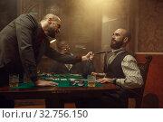 Купить «Poker player grabbed his opponent's tie, casino», фото № 32756150, снято 8 декабря 2019 г. (c) Tryapitsyn Sergiy / Фотобанк Лори