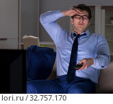 Купить «Businessman watching tv at night late», фото № 32757170, снято 15 марта 2018 г. (c) Elnur / Фотобанк Лори
