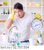 Купить «Man failing to meet the deadlines of housekeeping job», фото № 32757554, снято 18 февраля 2017 г. (c) Elnur / Фотобанк Лори