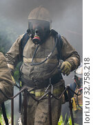 Купить «Firefighters of Fire Department Federal Fire Service during fire extinguishing, training to overcome fire zone of psychological training for firefighters», фото № 32758218, снято 7 августа 2019 г. (c) А. А. Пирагис / Фотобанк Лори