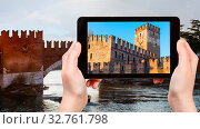 Travel concept - tourist photographs Castelvecchio (Scaliger) Castel in Verona city in Italy in spring evening on tablet. Стоковое фото, фотограф Zoonar.com/Valery Voennyy / easy Fotostock / Фотобанк Лори