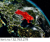 Купить «Ukraine from space at night with visible country borders. 3D illustration. Elements of this image furnished by NASA.», фото № 32763278, снято 23 февраля 2020 г. (c) easy Fotostock / Фотобанк Лори