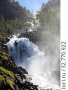 Latefoss or Latefossen consists of two separate streams flowing down. It is located on Norwegian National Road 13, Odda, Hordaland county, Norway (2018 год). Стоковое фото, фотограф Кекяляйнен Андрей / Фотобанк Лори