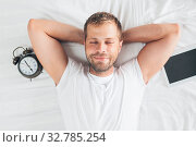 Tired man sleeping on bed after using his digital tablet. Стоковое фото, фотограф Zoonar.com/Tomas Anderson / easy Fotostock / Фотобанк Лори