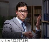 Купить «The businessman working late hours in the office», фото № 32787826, снято 25 января 2017 г. (c) Elnur / Фотобанк Лори