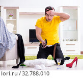 Man with mess at home after house party. Стоковое фото, фотограф Elnur / Фотобанк Лори