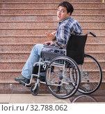 Купить «Disabled man on wheelchair having trouble with stairs», фото № 32788062, снято 14 апреля 2017 г. (c) Elnur / Фотобанк Лори