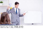 Купить «The business presentation in the office with man and woman», фото № 32788610, снято 7 августа 2017 г. (c) Elnur / Фотобанк Лори