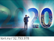 Купить «Businessman and concept of new year 2020», фото № 32793978, снято 7 апреля 2020 г. (c) Elnur / Фотобанк Лори