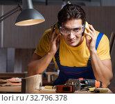 Купить «Worker working in repair workshop in woodworking concept», фото № 32796378, снято 11 августа 2017 г. (c) Elnur / Фотобанк Лори