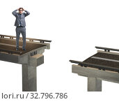 Купить «Young businessman with broken bridge isolated on white», фото № 32796786, снято 20 февраля 2020 г. (c) Elnur / Фотобанк Лори