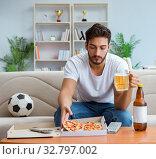 Купить «Man eating pizza having a takeaway at home relaxing resting», фото № 32797002, снято 18 июля 2017 г. (c) Elnur / Фотобанк Лори