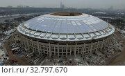 Купить «Luzhniki Arena under reconstruction, winter aerial view. Moscow, Russia», видеоролик № 32797670, снято 23 ноября 2019 г. (c) Данил Руденко / Фотобанк Лори