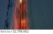 Купить «Aerial night video view on winter siberian road. Novosibirsk, Russia.», видеоролик № 32798062, снято 23 ноября 2019 г. (c) Serg Zastavkin / Фотобанк Лори