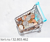Купить «Shopping cart with US coins on concrete plate», фото № 32803462, снято 29 января 2020 г. (c) easy Fotostock / Фотобанк Лори