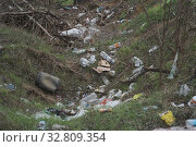 Купить «Elemental dump plastic garbage on the roadside near the outskirts of the forest. Pollution of the environment with plastic and other wastes. Plastic debris on the grass among trees. Environmental plastic pollution is ecological problem.», фото № 32809354, снято 13 декабря 2019 г. (c) Некрасов Андрей / Фотобанк Лори