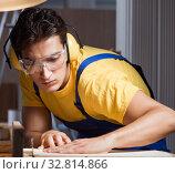 Купить «Worker working in repair workshop in woodworking concept», фото № 32814866, снято 11 августа 2017 г. (c) Elnur / Фотобанк Лори