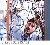 Купить «Electrician trying to untangle wires in repair concept», фото № 32815102, снято 7 июля 2017 г. (c) Elnur / Фотобанк Лори