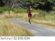 Купить «Vannes, FRANCE, Man Running on Country Road on Ile d'Arz, in Golfe de Morbihan,», фото № 32830034, снято 17 июля 2019 г. (c) age Fotostock / Фотобанк Лори