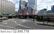 Купить «The modern high-rise buildings and road junctions surroundings the Osaka station. Japan», видеоролик № 32890778, снято 1 января 2020 г. (c) Serg Zastavkin / Фотобанк Лори