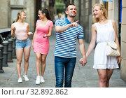 Купить «couple taking a walk in town», фото № 32892862, снято 6 апреля 2020 г. (c) Яков Филимонов / Фотобанк Лори