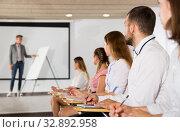 Купить «Side view of young people in auditorium», фото № 32892958, снято 25 июля 2018 г. (c) Яков Филимонов / Фотобанк Лори