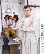 Купить «Young man in quest room with bloody traces», фото № 32893110, снято 8 октября 2018 г. (c) Яков Филимонов / Фотобанк Лори