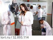 Купить «Girl using telephone set in escape room», фото № 32893114, снято 8 октября 2018 г. (c) Яков Филимонов / Фотобанк Лори