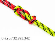Reef, Hercules, square, double or brother hood Binding knot binding two colored (red and green) ropes. nautical loop used to secure rope or fishing line around an object. Isolated on white background. Стоковое фото, фотограф Алексей Ширманов / Фотобанк Лори