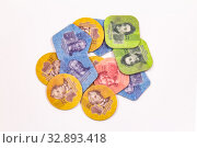 Pile of folded plastic money 1,3,5,10 ruble Isolated on white background. Coins of different shapes for visually impaired people. Unrecognized Republic of Transnistria declared its independence. Стоковое фото, фотограф Алексей Ширманов / Фотобанк Лори
