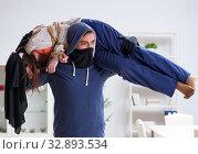 Купить «Armed man assaulting young woman at home», фото № 32893534, снято 15 декабря 2017 г. (c) Elnur / Фотобанк Лори